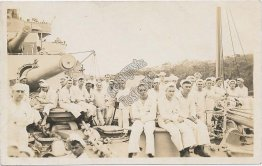 Large Group of Navy Sailors, Sitting on Deck of Ship - Early 1900s RP Postcard