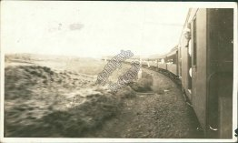 US Navy Sailor Riding a Train - Early 1900's Real Photo RP Postcard