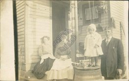 Family, Girl Standing on Barrel, Toy Wagon, Doll - Early RP Photo Postcard